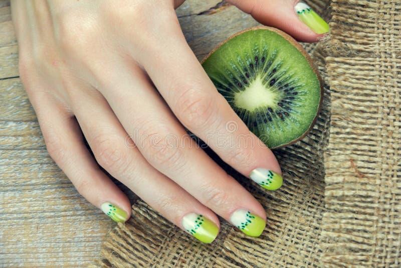 Kiwi art manicure stock photos