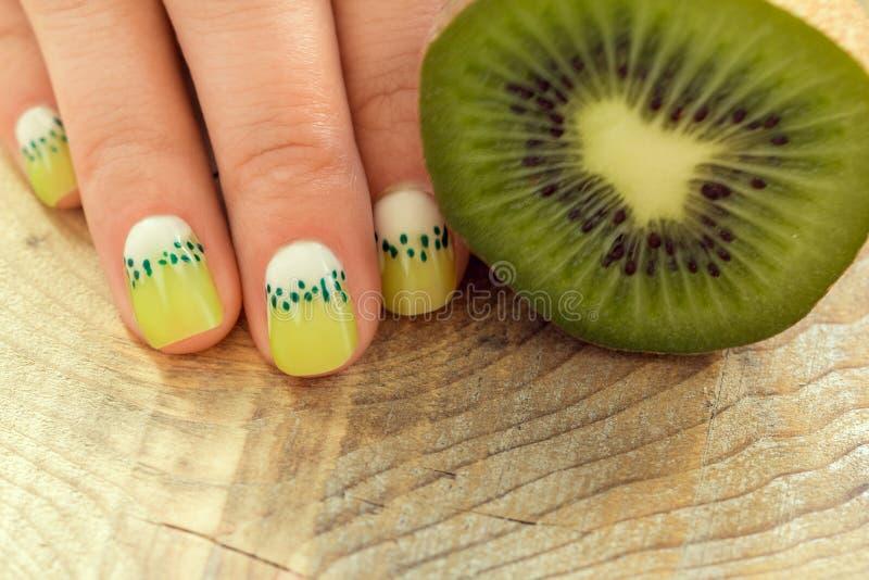 Kiwi art manicure stock photo