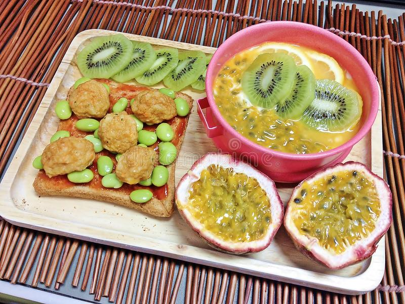 Kiwi and passion fruit yogurt with fish ball mixed tomatoes sauce splash on the breads stock photos