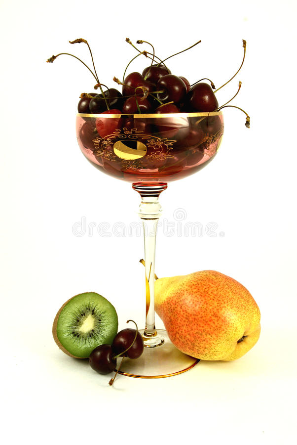 Kiwi, pear and cherry royalty free stock images