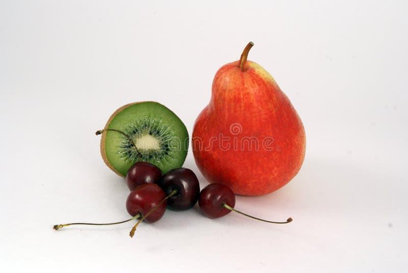 Kiwi, pera e ciliegia immagine stock
