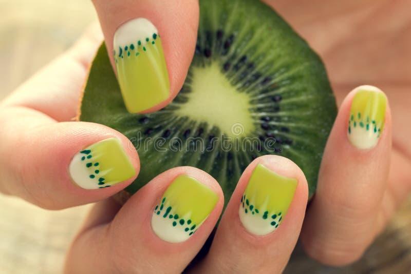 Kiwi art manicure royalty free stock image