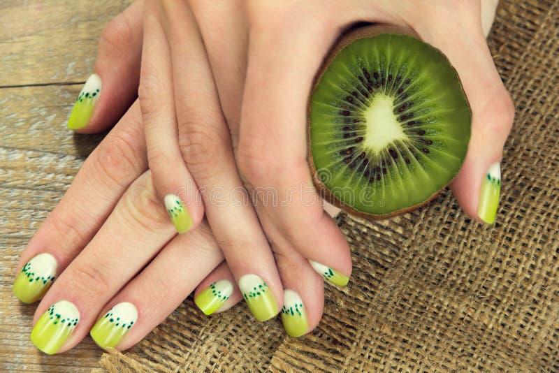 Kiwi art manicure stock image