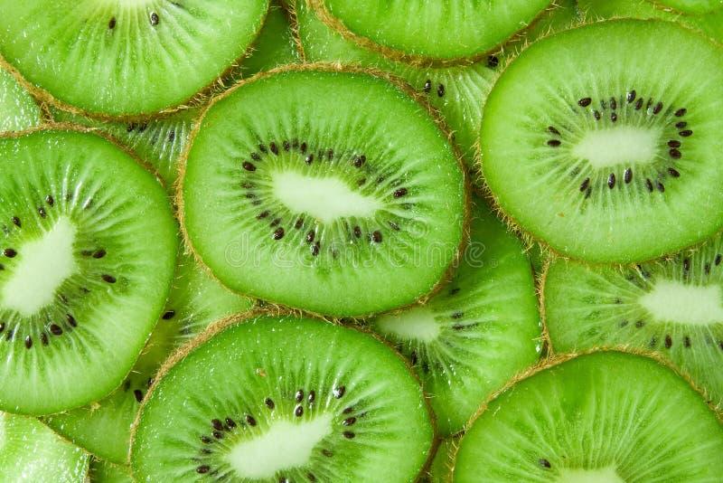 Kiwi slices. Close up background of green kiwi slices royalty free stock image