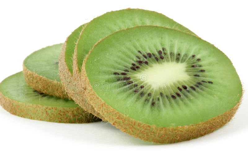Kiwi slices. Isolated on the white background royalty free stock photo