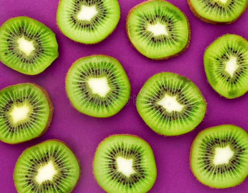 Kiwi slices as bacground. Kiwi Fruit. Kiwi slices as background. Texture, background of the kiwi. Kiwi Fruit close-up stock photography