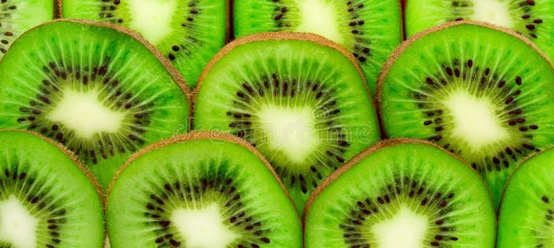 Kiwi slices as background. Kiwi Fruit close-up. Kiwi slices as bacground. Texture, background of the kiwi. Kiwi Fruit close-up royalty free stock photos
