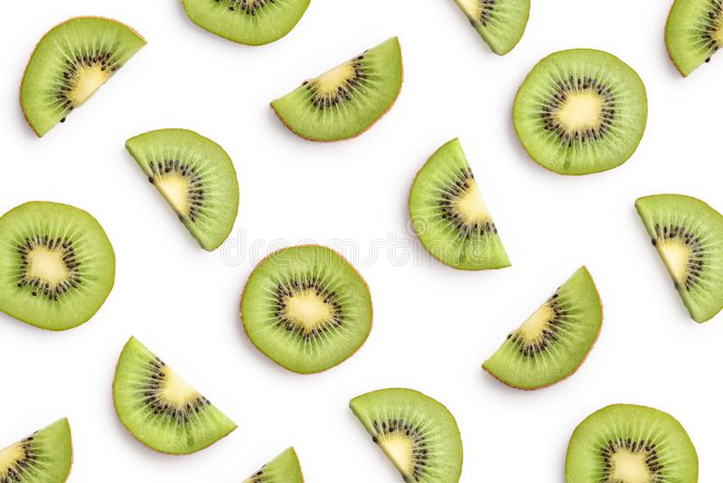 Kiwi slices as pattern. Isolated on white background royalty free stock photography