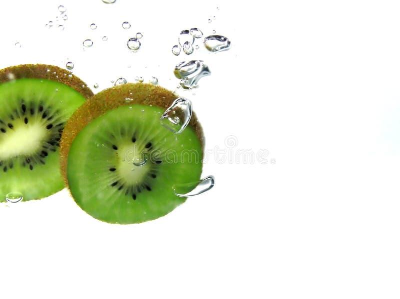 Kiwi slices and bubbles stock photos