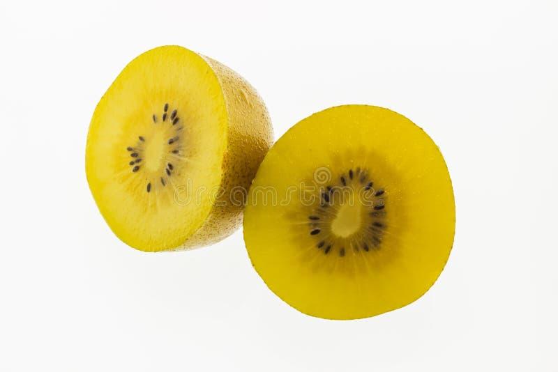 Kiwi slices into half on white. Background stock photo