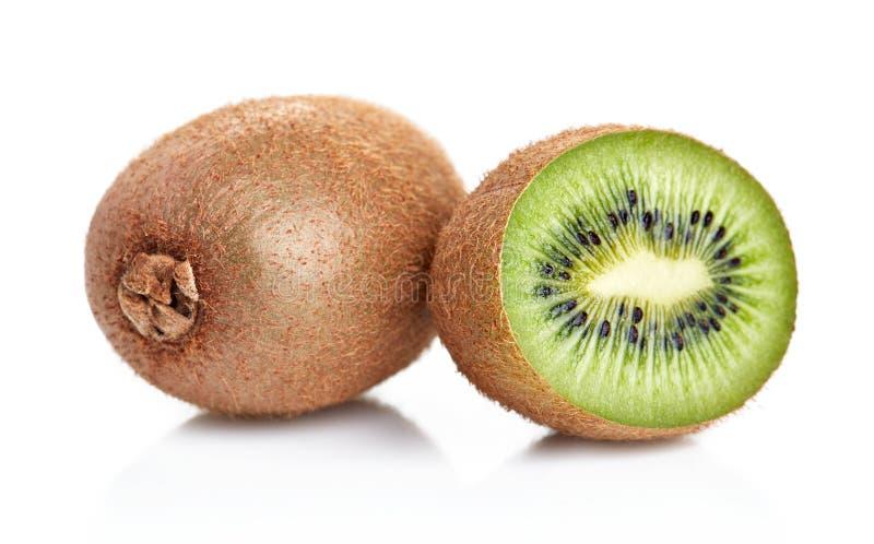 Kiwi slices isolated. Heap of ripe kiwi slices isolated on white background stock images