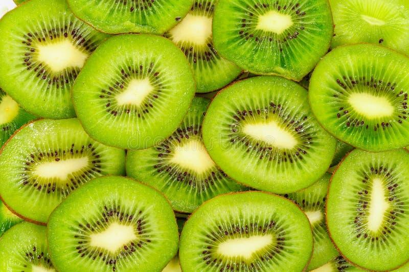 Kiwi,Slices of kiwi background stock photos