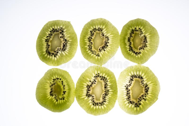 Kiwi slices. Lit from the back stock images