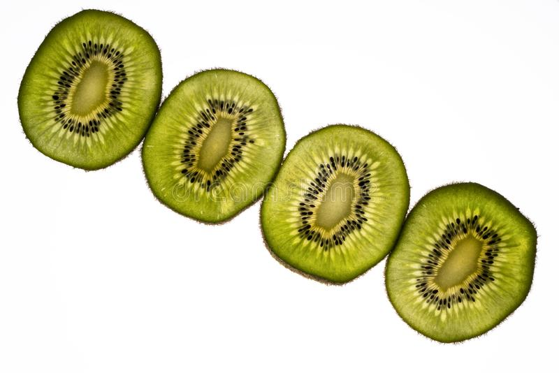 Kiwi slices. Lit from the back royalty free stock photos