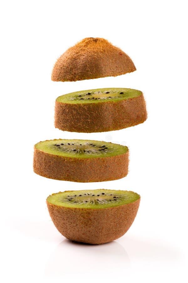 Kiwi slices levitating on white. Background royalty free stock photos