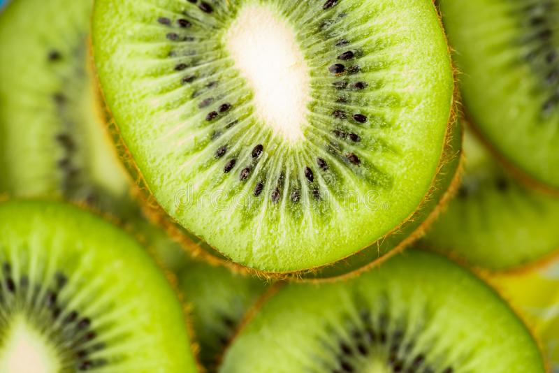 Kiwi slices and light royalty free stock images