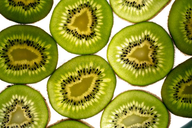 Kiwi slices and light royalty free stock photos