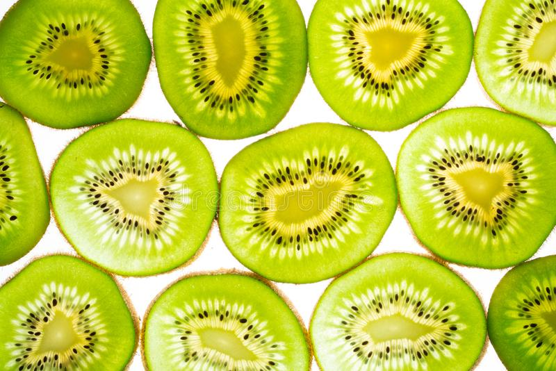 Kiwi slices and light. Green kiwi slices and light royalty free stock images