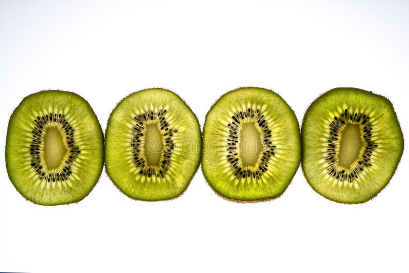 Kiwi slices. Lit from the back royalty free stock image