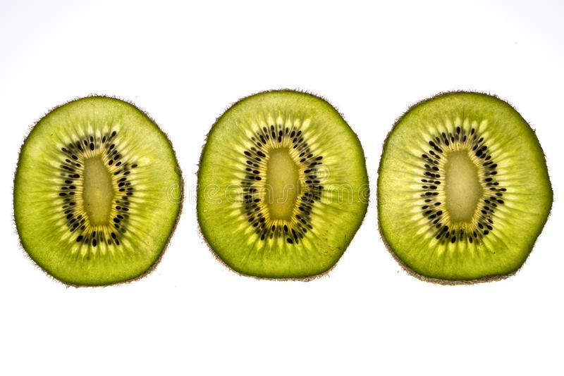 Kiwi slices. Lit from the back stock photography