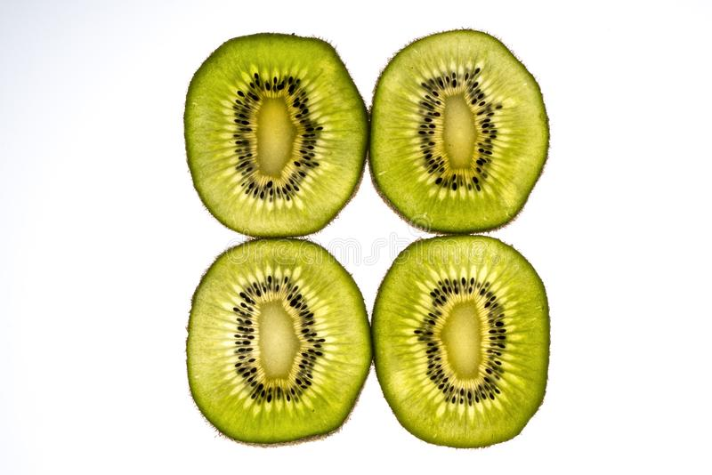 Kiwi slices. Lit from the back stock photos