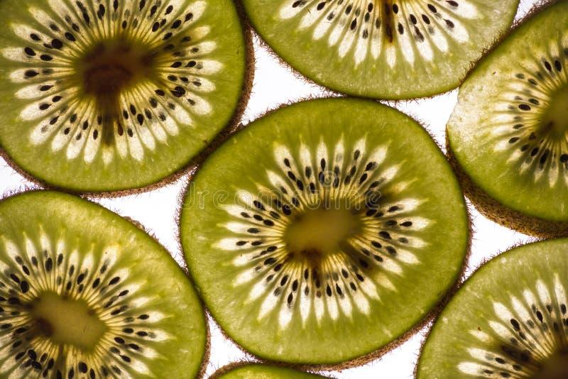 Kiwi Slices retroilluminato immagini stock