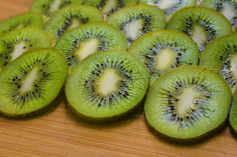 Kiwi slices on a wooden dish. Natural fresh tropical fruit royalty free stock images