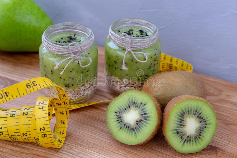 Kiwi smoothie with cereal on a wooden table. royalty free stock photography