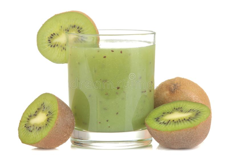 Kiwi smoothies in a glass next to fresh  kiwi slices on  a white isolated background. fruit drink. Kiwi smoothies in a glass next to fresh kiwi slices on a white stock images