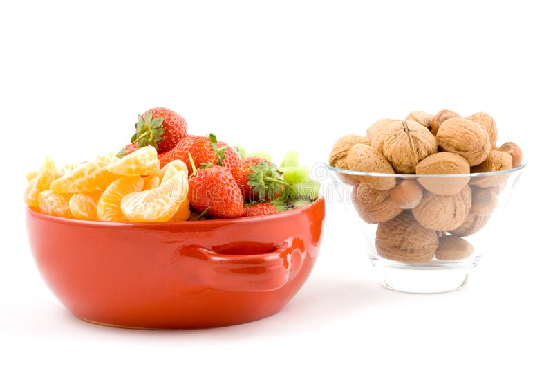 Kiwi, strawberry and mandarine, tangerine with mixed nuts royalty free stock photo