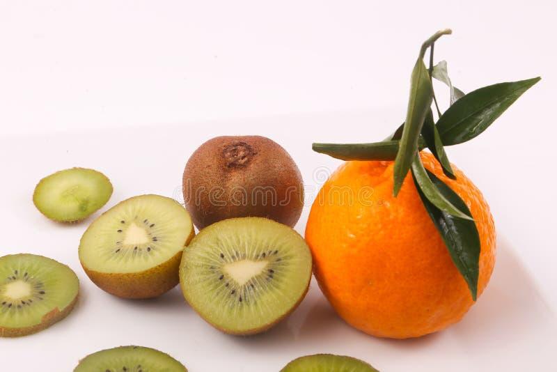 Kiwi and Tangerine fruit. Kiwi fruit with kiwi slices and tangerine on white background royalty free stock images