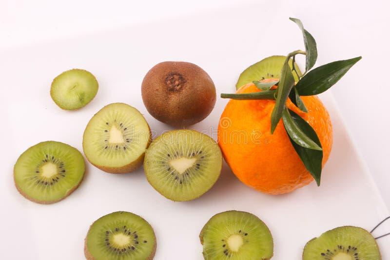 Kiwi and Tangerine fruit. Kiwi fruit with kiwi slices and tangerine on white background stock image