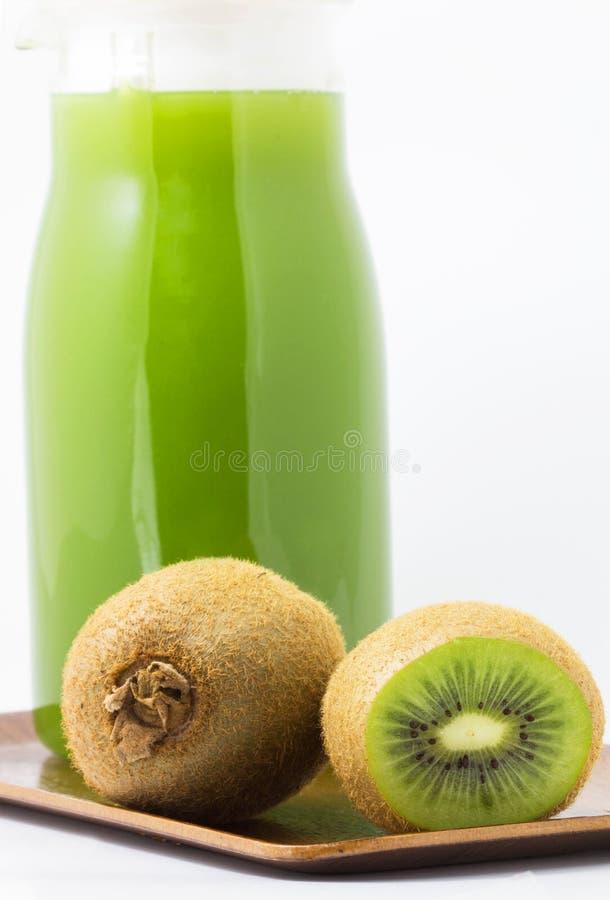 Kiwi z sokiem fotografia stock