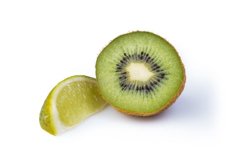 Kiwifruit en kalk stock foto