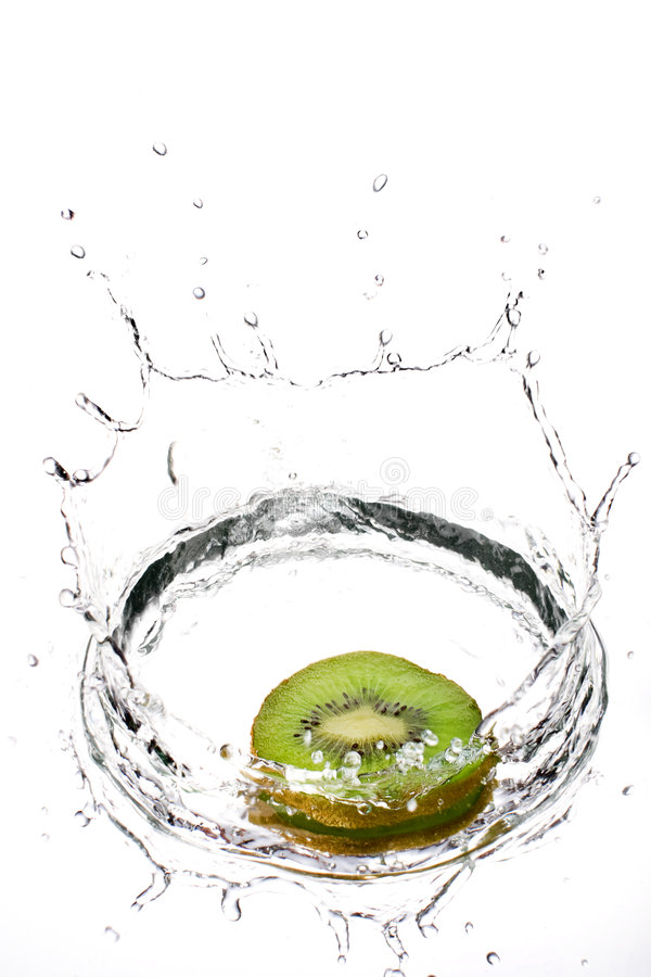 Kiwifruit in medium splash royalty free stock images