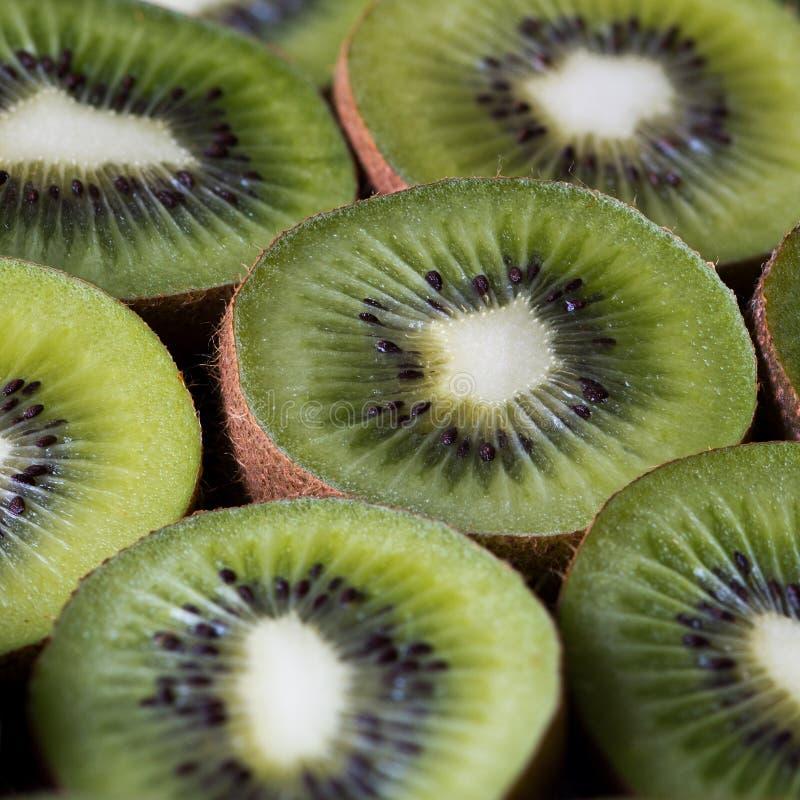 Kiwifruit (often shortened to kiwi). Closeup of kiwifruits. Kiwifruit (often shortened to kiwi) or Chinese gooseberry royalty free stock photos