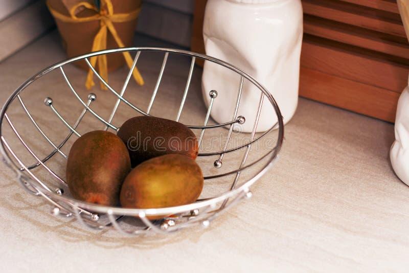 Kiwis in a metallic basket stock images