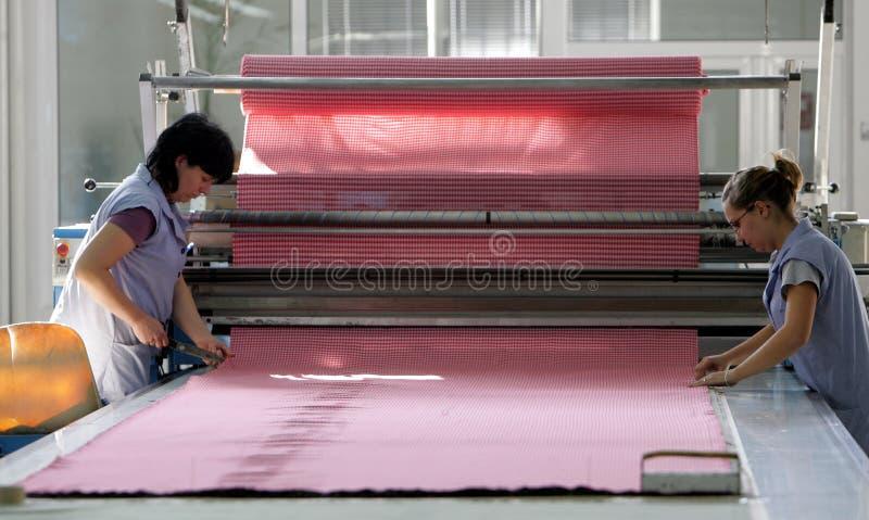 Klädfabriksarbetare arkivfoton