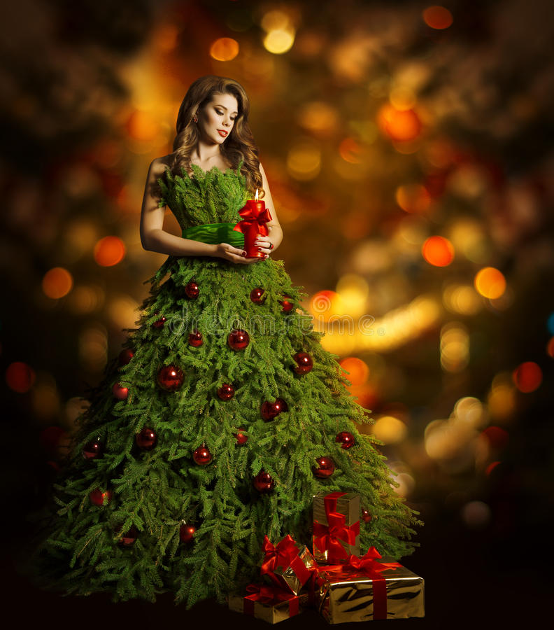 Klänning för julgrankvinnamode, modell Girl, Xmas-ljus arkivbilder