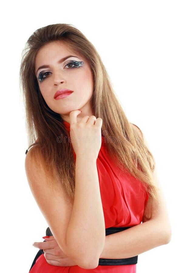 klänning som poserar den röda kvinnan arkivfoto