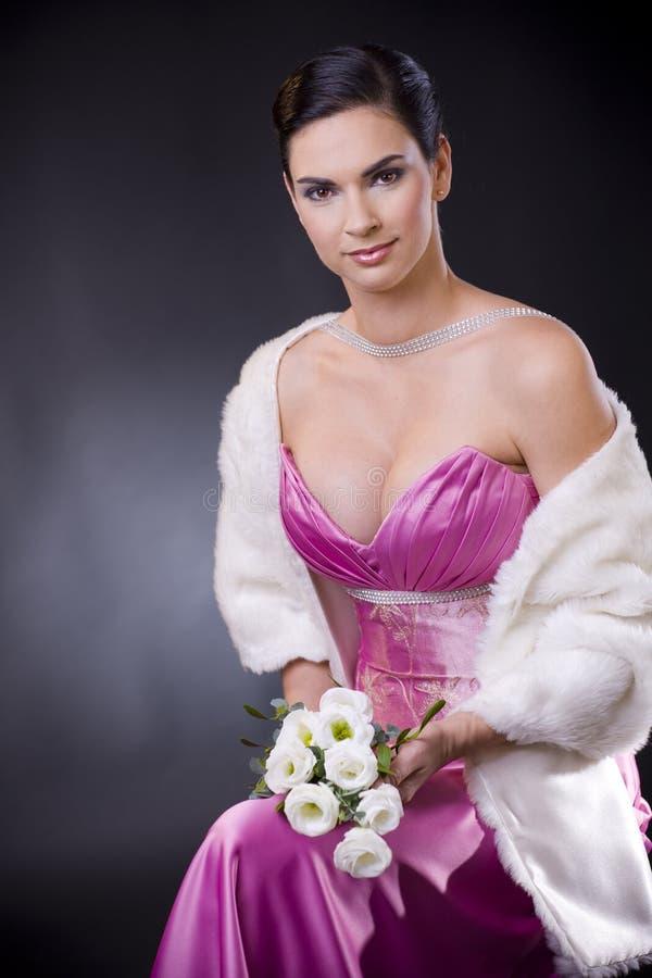 klänningaftonkvinna royaltyfri foto