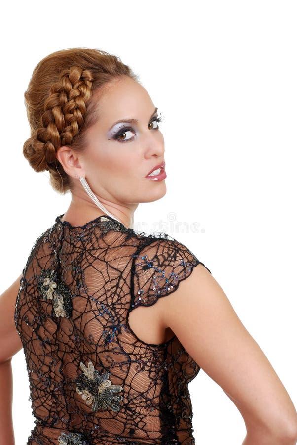 klänningen snör åt den slitage kvinnan royaltyfria bilder