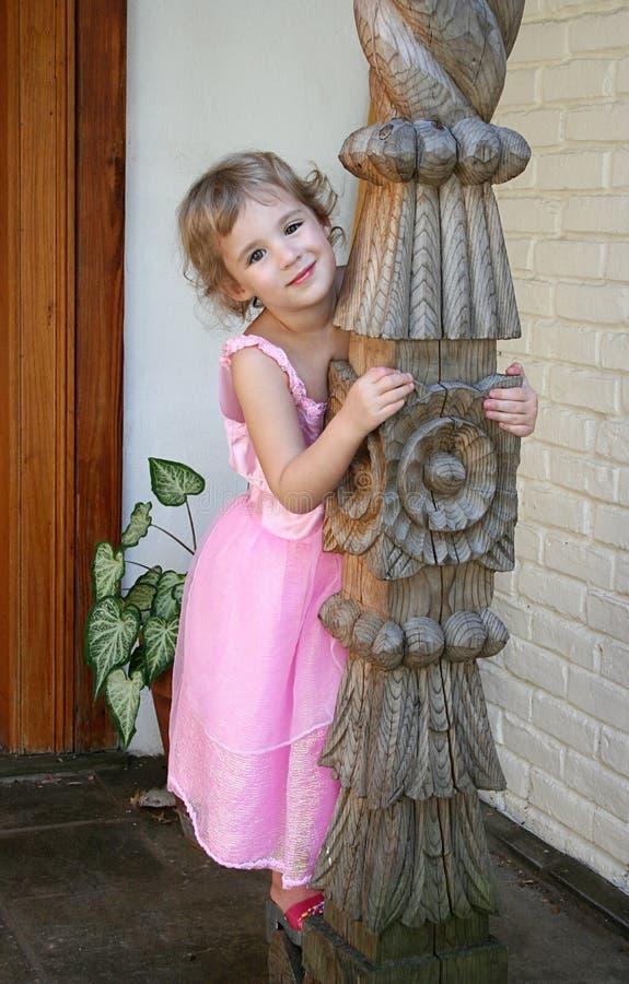 klänningflicka little pink arkivfoto