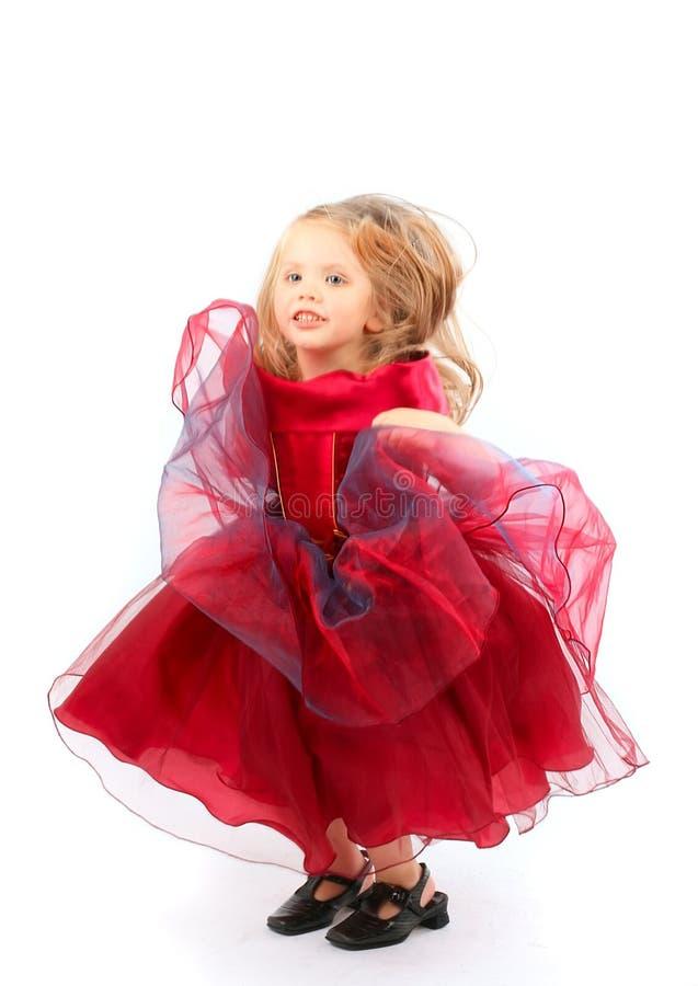 klänningflickared arkivfoto