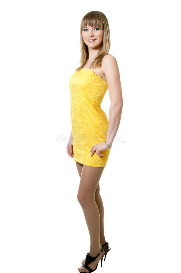 klänningflickayellow royaltyfri foto