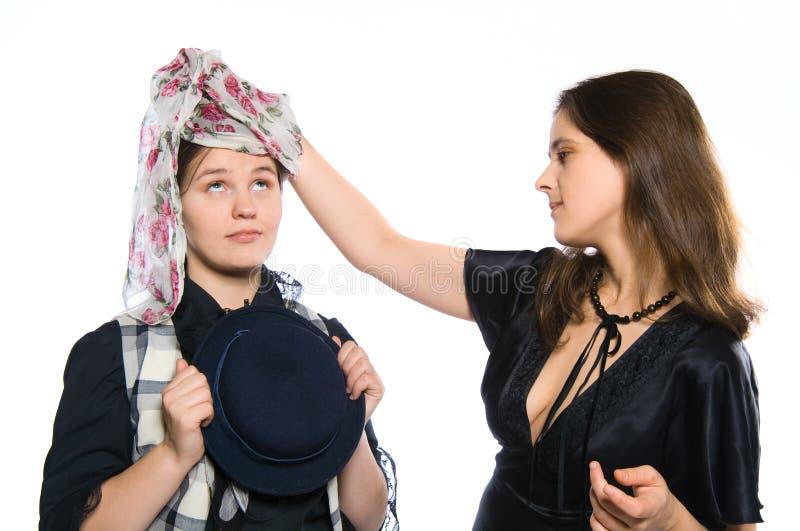 klänningmonteringskvinna royaltyfri foto