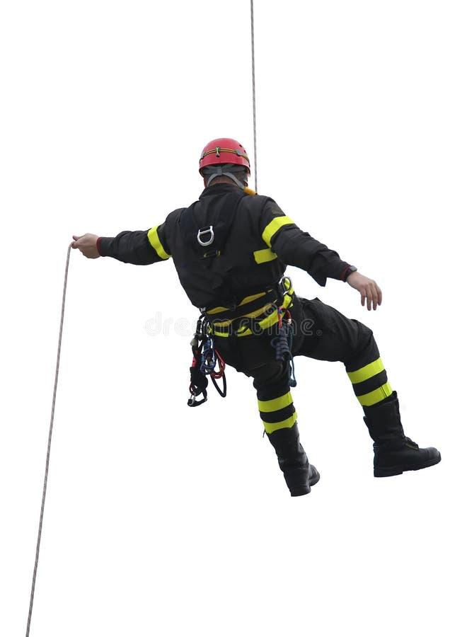 Klättrare av brandmän med den röda hjälmen fotografering för bildbyråer
