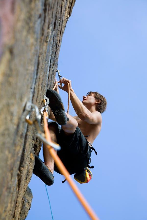 klättringen knyter rockrep två arkivfoton