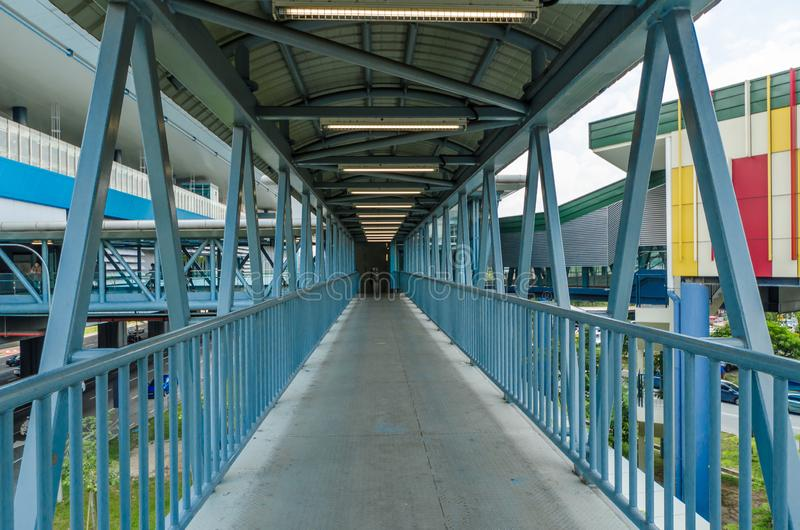 A link bridge connects the Cheras Leisure mall directly to the Taman Mutiara station. People can seen walking through the bridge. KL, Malaysia - April 5,2019 stock photography