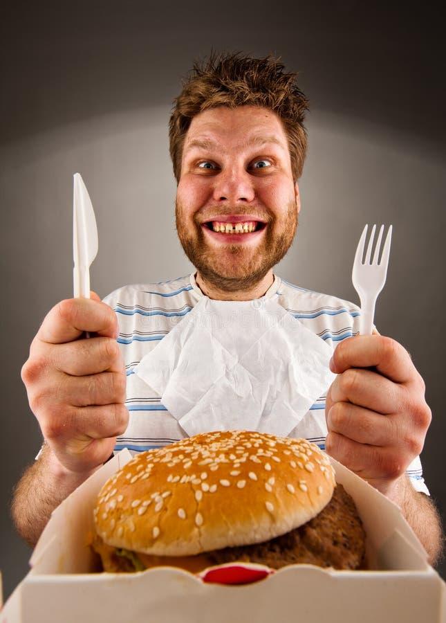 Klaar om hamburger te eten royalty-vrije stock foto's